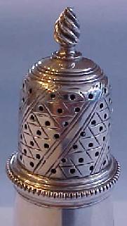 Detail of the top of Detail of the top of the  superb Georgian sterling silver pepper caster, London 1768.