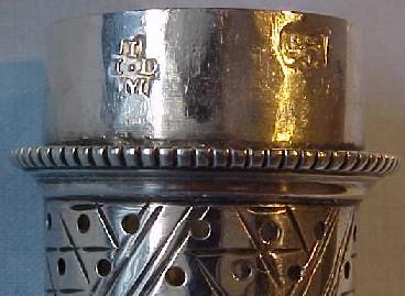 Lid hallmarks on superb Georgian sterling silver pepper caster, London 1768.